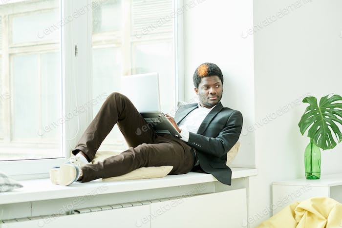 African Businessman Resting in Office
