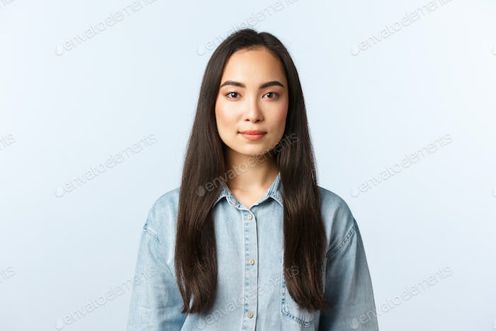 Lifestyle, people emotions and beauty concept. Young woman with long dark hair looking camera with