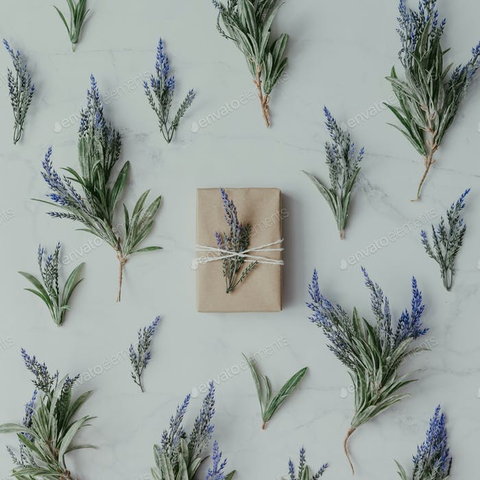 Creative mock up layout made of lavender branches with wrapped soap on table.