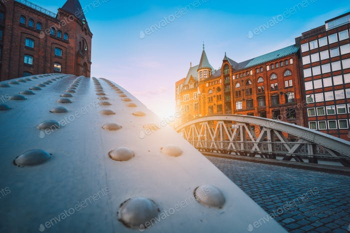 Perspective of iron arch bridges in historical warehouses in Speicherstad district in Hamburg