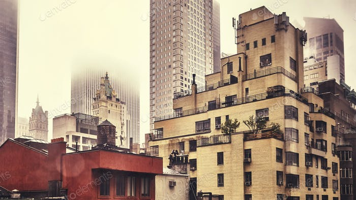 New York City old residential buildings on a rainy day.