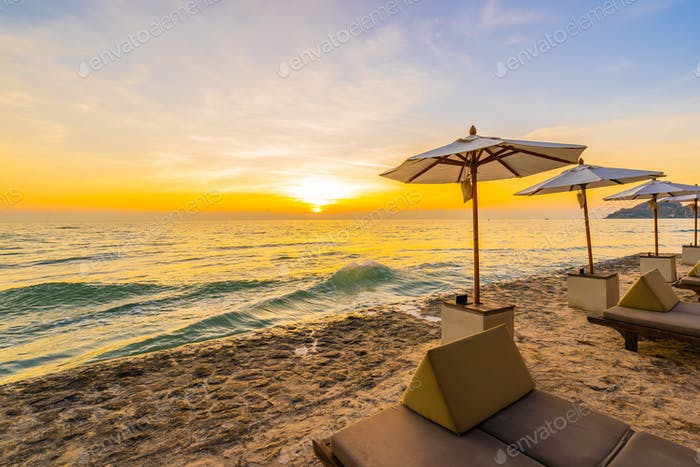 Umbrella and chair with pillow around beautiful landscape of bea
