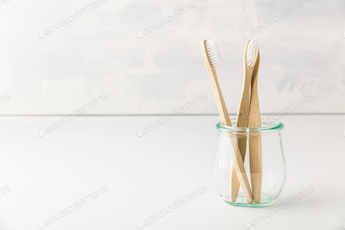 Wooden bamboo tooth brushes in a glas jar