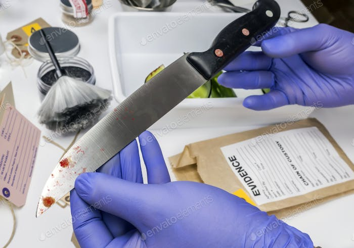 Scientist takes samples of a knife in laboratory, conceptual image