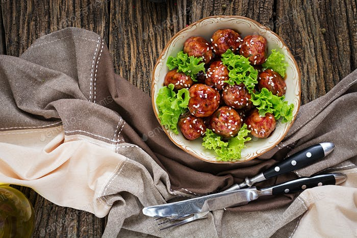 Meatballs with beef in sweet and sour sauce. Asian food. Top view. Flat lay