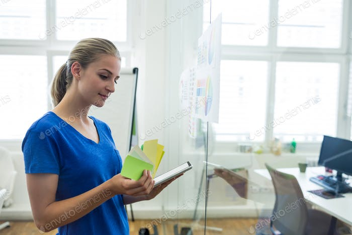 Female graphic designer using digital tablet