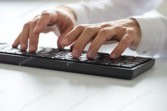 Closeup of computer programmer typing