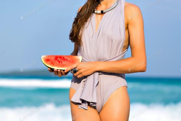 pretty woman eating watermelon