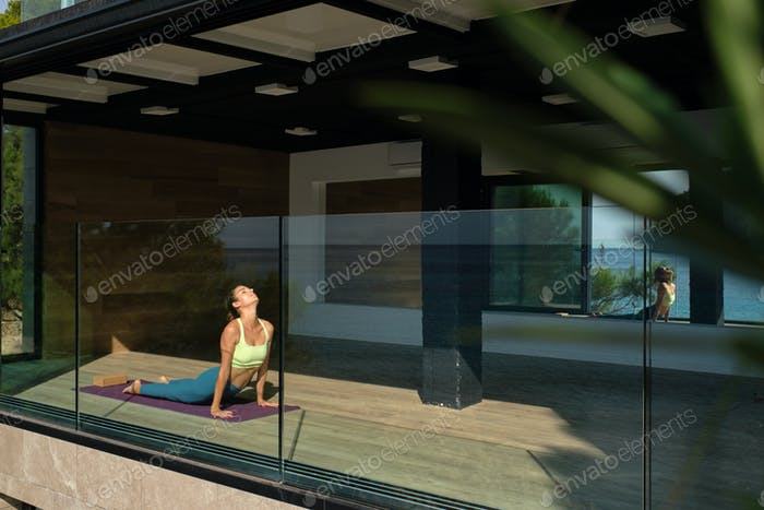 Calm woman doing yoga in Cobra position