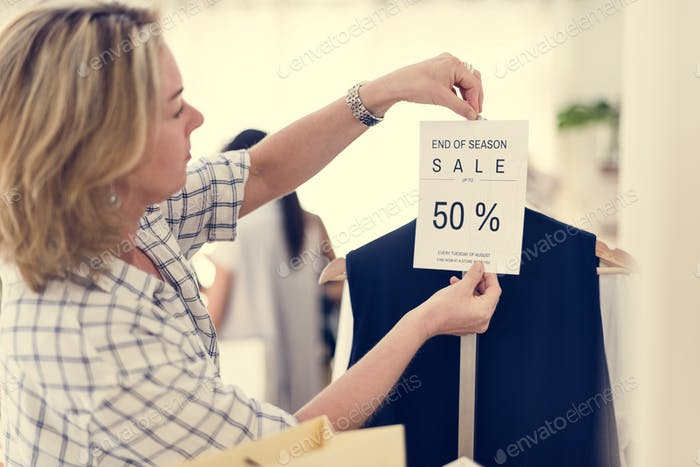 Woman checking out discounted clothes