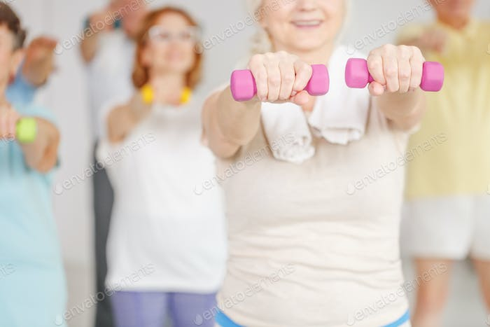 Exercising shoulders with dumbbells