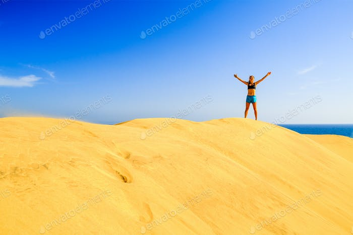 Runner success on beach sand dunes