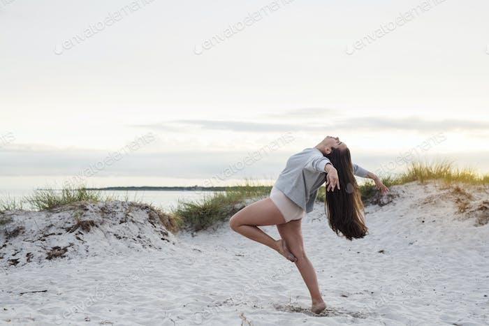 Dancer practicing on beach