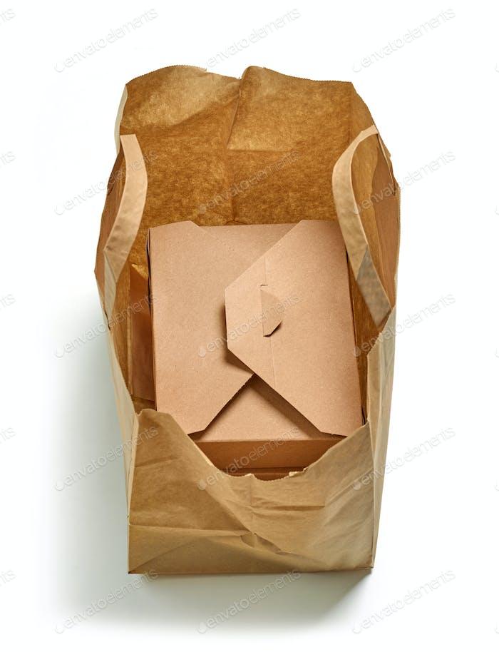 cardboard box in paper bag