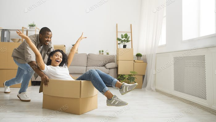 Female in box and guy pushing her by the room