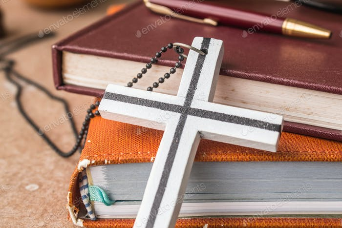 Cross against an old book