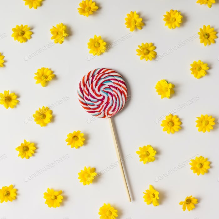 Colorful lollipop and yellow flowers pattern.