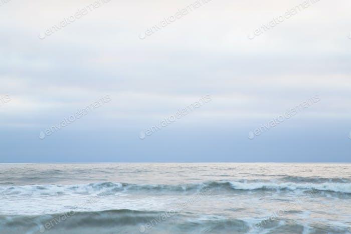 Seascape at dusk on the Pacific Ocean coastline.