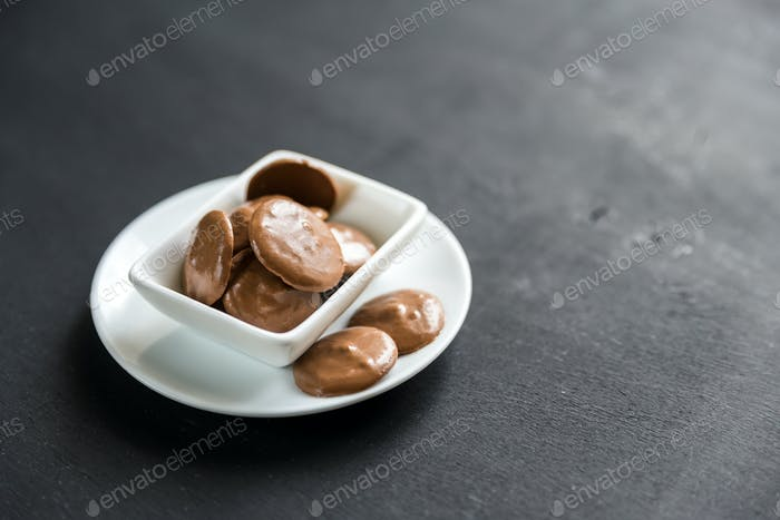 Chocolate candies in porcelain bowl