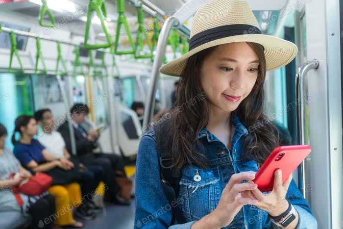 Woman use of cellphone on train