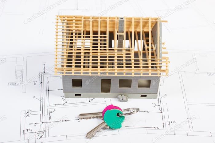 Electrical drawings and diagrams with house under construction and home keys, building home concept