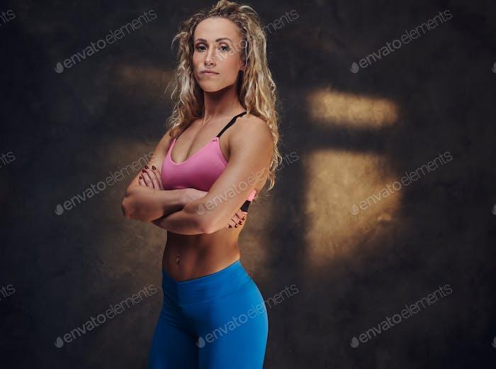 Portrait of pretty blond woman in sport suit