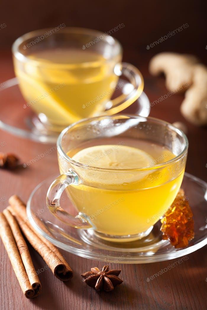 hot lemon ginger cinnamon tea in glass cup