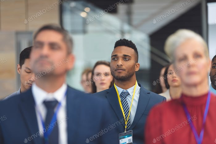 Front view of attentive young African american businessman in a business seminar in office building