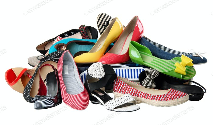 Pile of various female shoes over white, with clipping path