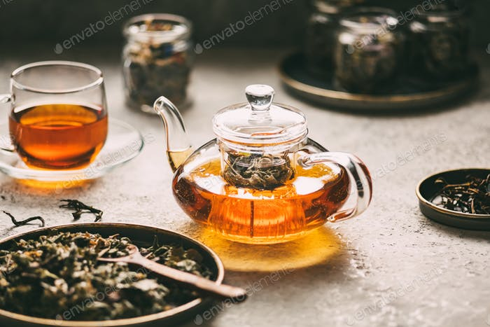 Teapot with fresh tea from different herbs
