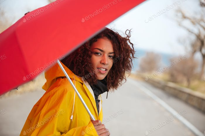 Woman looking camera in raincoat