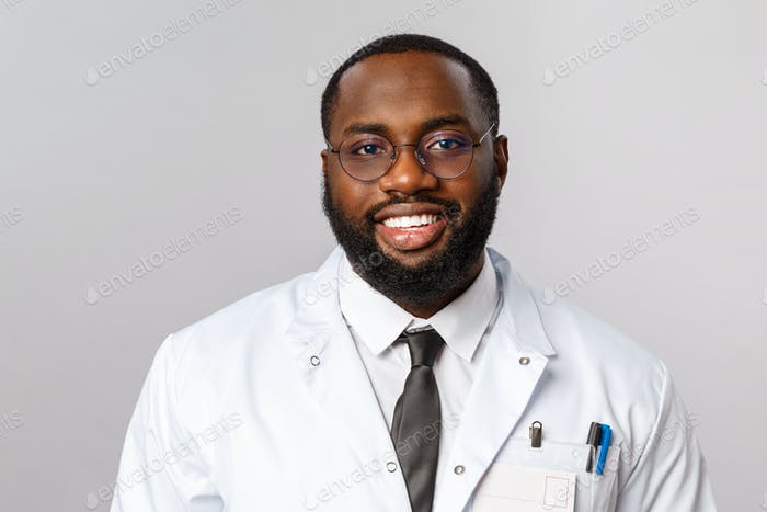 Healthcare, medicine and hospital treatment concept. Close-up portrait of smiling handsome african