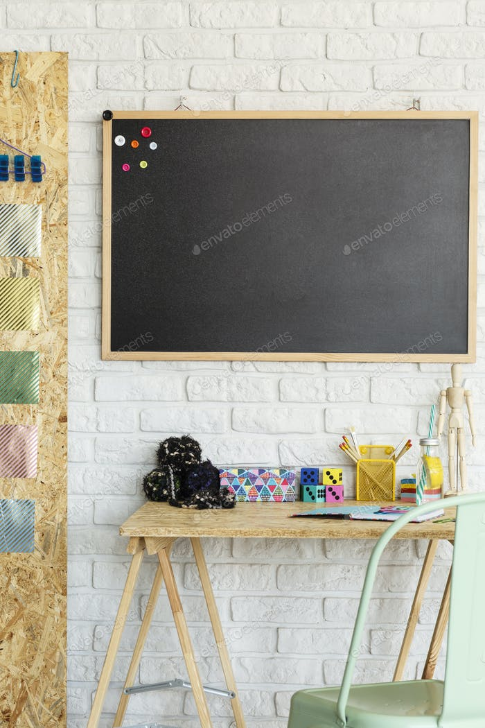 Room with blackboard and desk