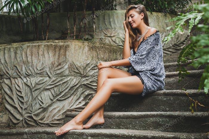 young slim woman in tropical Bali villa