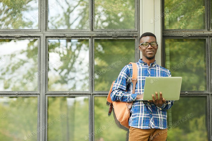 African-American Student Posing with Laptop Outdoors
