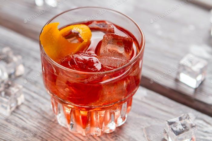 Glass with dark orange drink