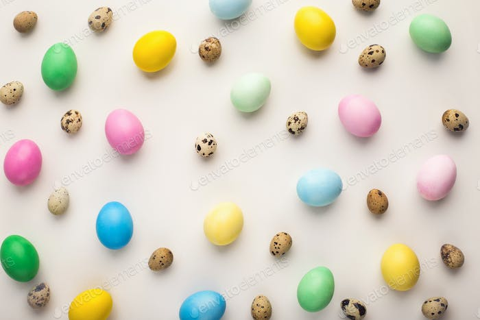 Easter background. Colored eggs on white, isolated