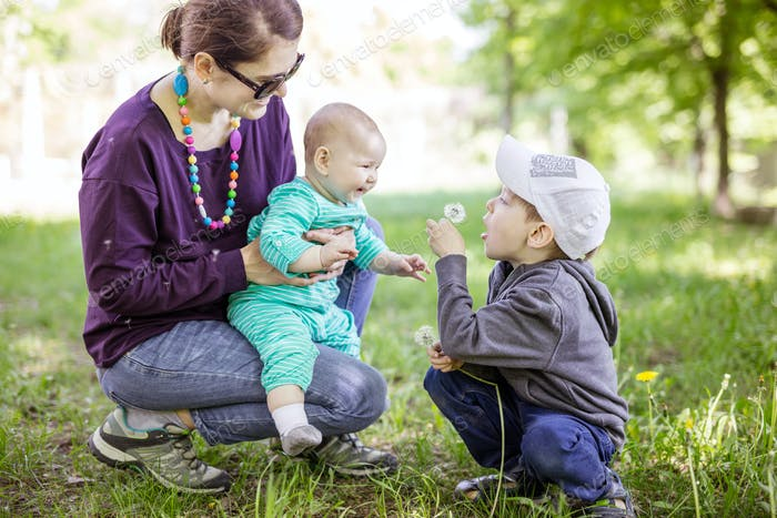 Caucasian young woman with baby daughter and preschool son