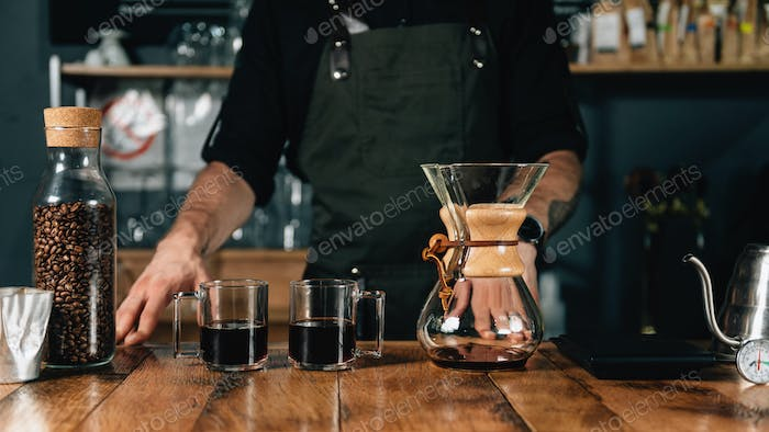 Two Glass Mugs of Chemex Coffee On Wooden Table