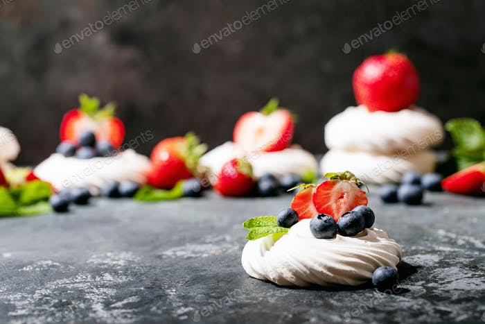 Dessert pavlov with strawberries and blueberries