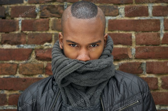 Male fashion model with scarf covering face