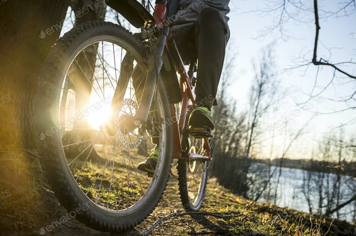 Cyclist resting after a drive along the river bank