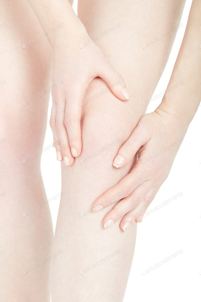 Woman fatigued leg with knee pain isolated on white, clipping pa