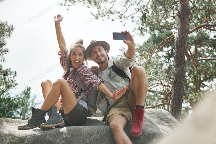 Young couple making a selfie during hiking trip