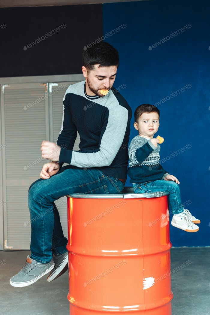little boy and father playing together