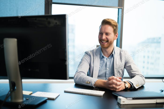 Businessman at his working desk in office