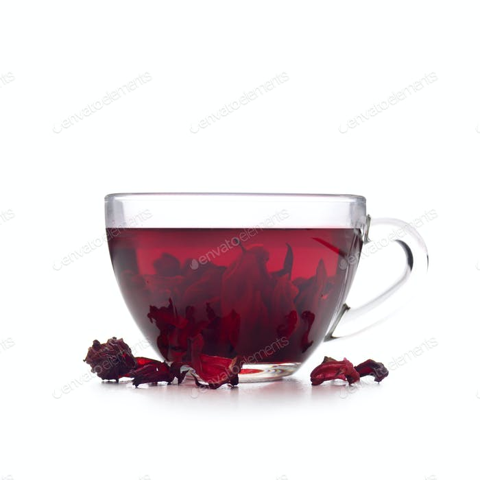Hibiscus Tea cup with petals aside isolated on white background