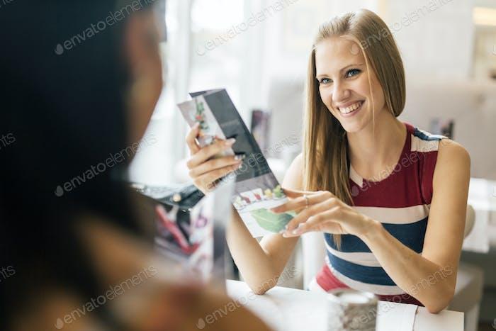 Friends chatting in restaurant