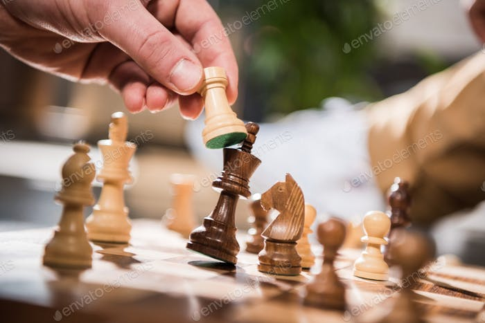 partial view of man playing chess game
