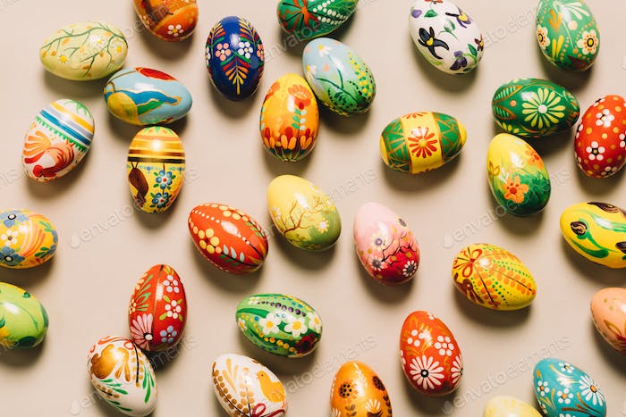 Bunch of colorful decorated eggs on the floor